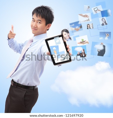 business man shows touch screen tablet pc with streaming images, concept for business and cloud computing, asian man model