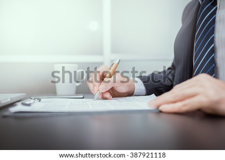 Business man signing a contract. Lawyers are signing on paper. Businessmen are signed resignation.  - stock photo