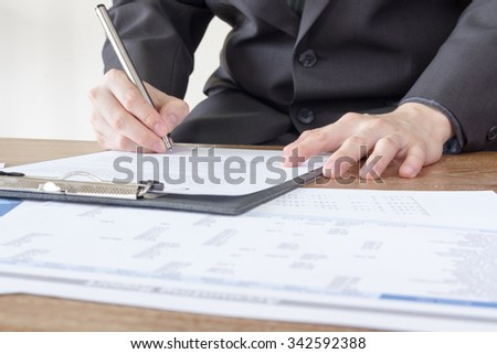 business man signing contract document form