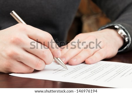 Business man signing documents - stock photo