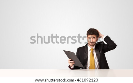 Business man sitting at white table with a folder on white background