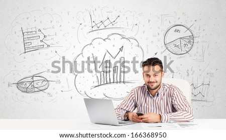 Business man sitting at white table with hand drawn graph charts - stock photo