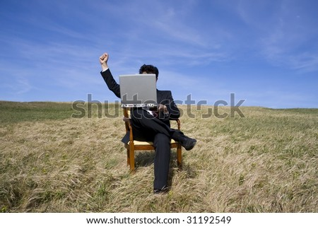 Business man sitting on a chair working out - stock photo