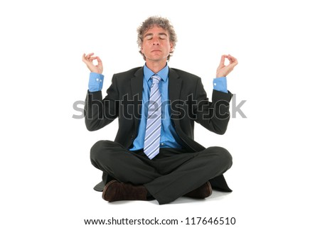 business man sitting on floor in meditation
