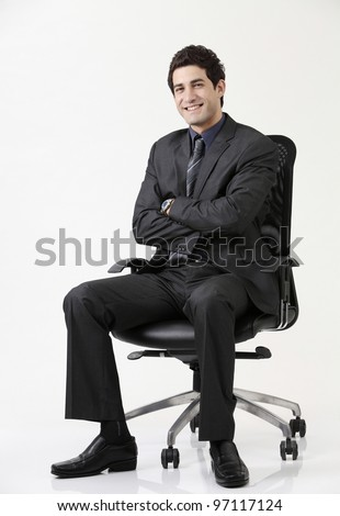 Business man sitting on office  chair crossing arm - stock photo