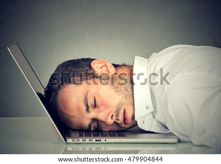 Business man sleeping on his laptop in his office