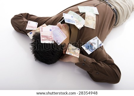Business man sleeping with many euro banknotes