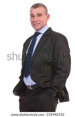 business man smiling for the camera while holding his hands in his pockets. on a white background