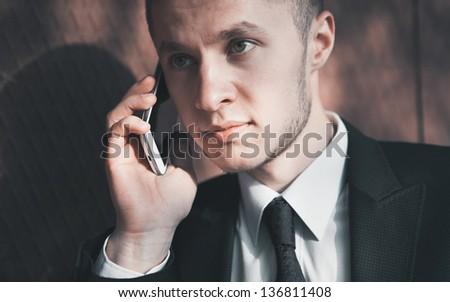 business man speaking on a mobile phone - stock photo