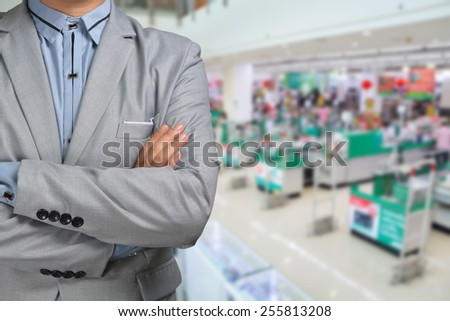 Business Man stand in Hypermarket or Supermarket store present retail marketing - stock photo