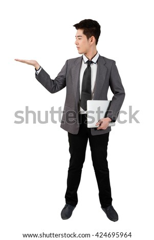 business man stand open one hand  another hold notebook full body isolated - stock photo
