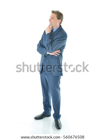 Business man standing and thinking of new ideas or solutions to business problems