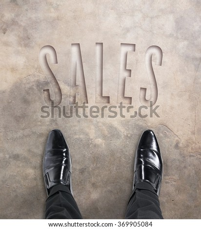 Business man standing at the beginning of a journey to sales