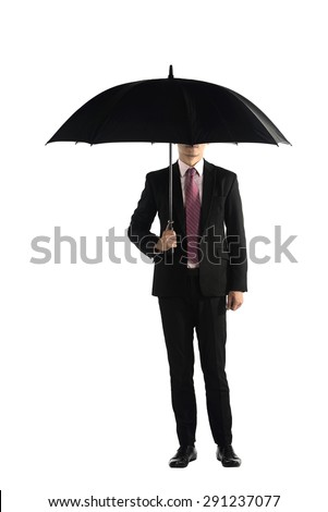 Business man standing holding umbrella isolated over white background