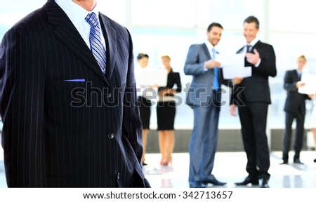 business man standing in an office