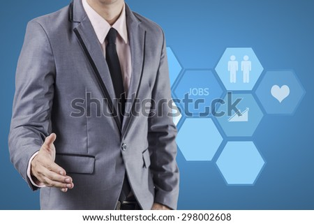 Business man standing on blue background. - stock photo
