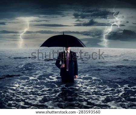 Business man standing on the sea in the middle of storm - stock photo