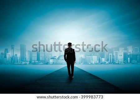 Business man standing on wooden bridge and looks at the city, Business success concept