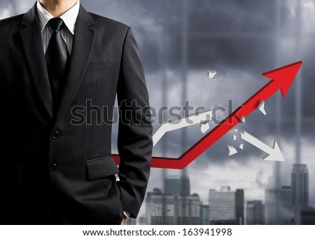 Business man standing with growth chart, success concept - stock photo