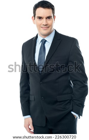 Business man standing with his hands in pockets - stock photo