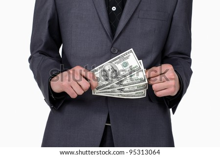 Business man standing with some american dollars in his hands, close up