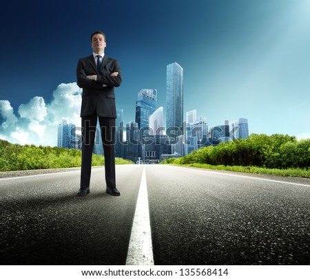 business man stay on the road - stock photo