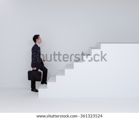 Business man stepping up on white stairs