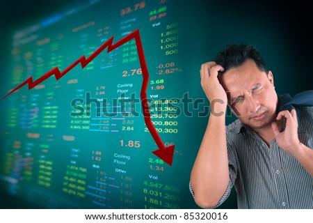 Business man stress about falling of stock market - stock photo