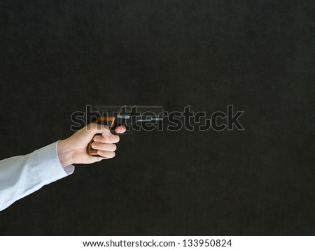 Business man, student or teacher pointing a gun with copy space - stock photo