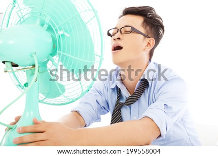 business man  suffering a hot  summer heat with fans - stock photo