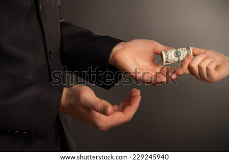 business man takes a bribe, on a black background