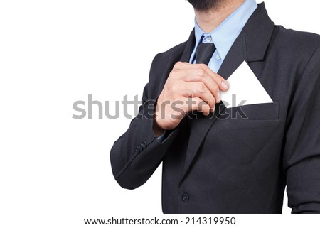 business man takes out business card from the pocket of business suit isolated on white background - stock photo
