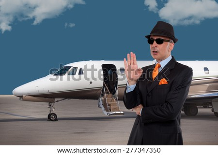 Business man talking next to a private jet  - stock photo