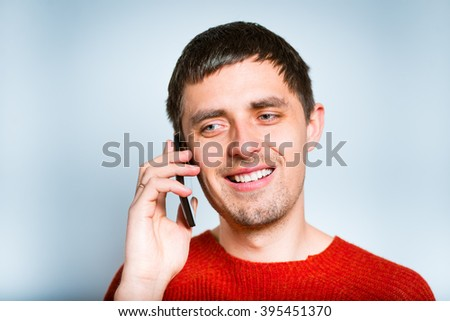 Business man talking on the phone, isolated on a gray background - stock photo