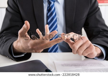 Business man talking with hands about rules and regulations. - stock photo