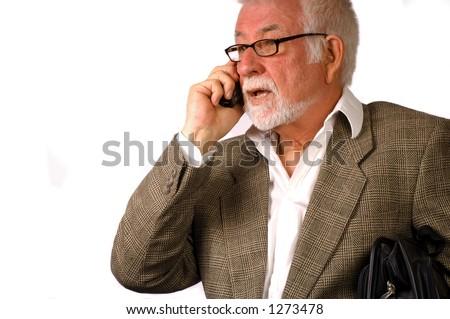 Business man talks on phone - stock photo