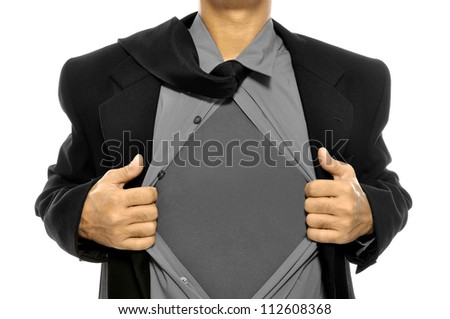 Business man tears open his shirt in a super hero fashion getting ready to save the day isolated over white background - stock photo