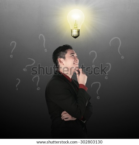 Business man thinking with light bulb top of his head