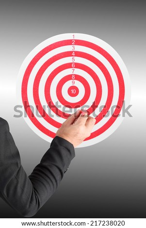 business man throwing darts at dart board red line  - stock photo