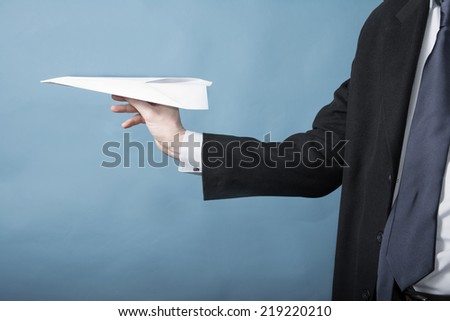 Business man throws a paper airplane - stock photo