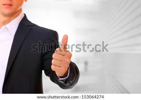 Business man thumb up positive sign
