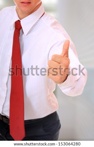 Business man thumb up positive sign - stock photo