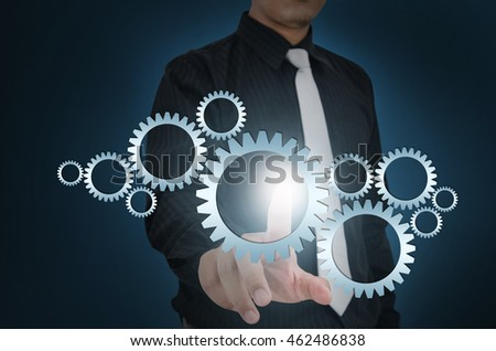 Business man touch gear elements on screen