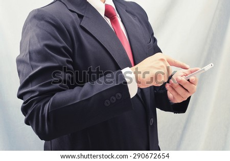 business man touch smart phone - stock photo