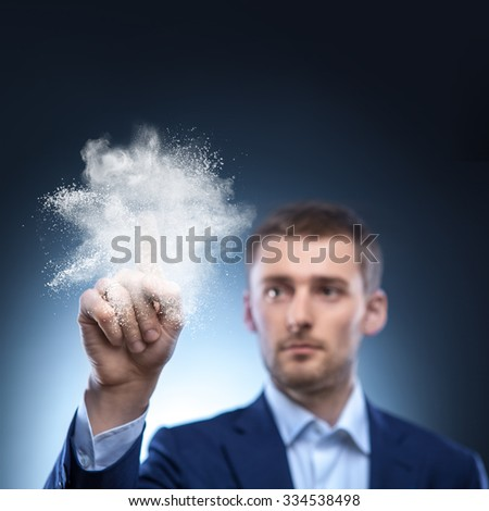 business man touch splash of white powder in air - stock photo