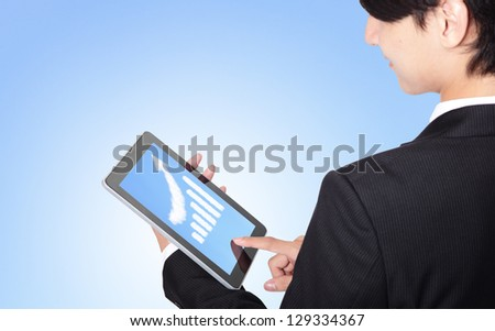 business man touch tablet pc, with a growth graph ( made by cloud ) in the air with blue sky, finance and business concept, asian model
