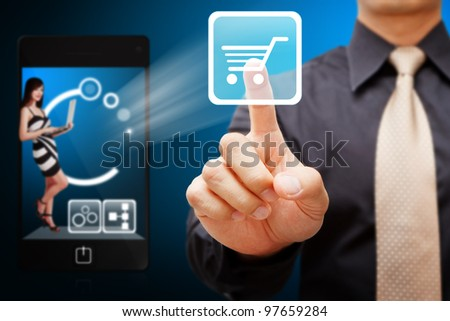 Business man touch the Cart icon from mobile phone - stock photo