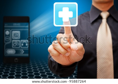 Business man touch the First Aid icon - stock photo