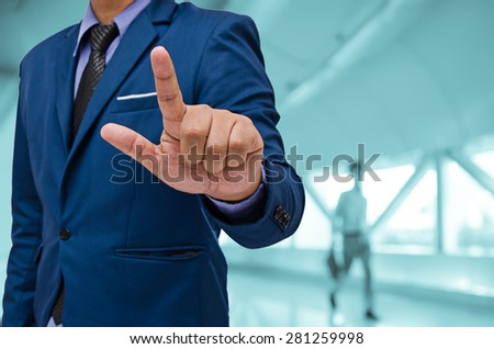 business man touch virtual screen - stock photo