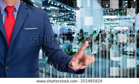 business man touch visual graph on screen with night city background